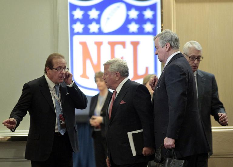 New England Patriots owner Robert Kraft, second from left, leaves NFL labor negotiations with the owners delegation Wednesday. (AP)