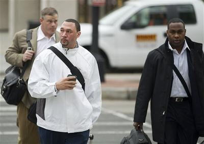 Pittsburgh Steelers quarterback Charlie Batch, center, New York Jets fullback Tony Richardson, right, and former NFL player Pete Kendall arrive for talks on the NFL labor deal in Washington.(AP)