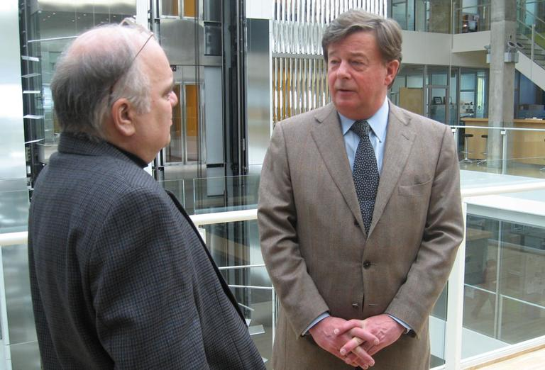 Henri Termeer speaks with WBUR's Bob Oakes at Genzyme headquarters Wednesday. (Curt Nickisch/WBUR)