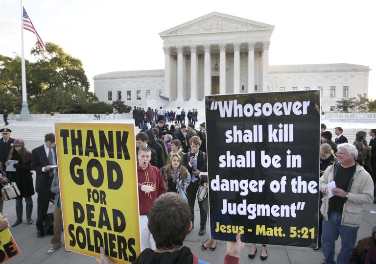 Westboro Baptist Church members in front of the Supreme Court in Washington, D.C., holding signs they take to their protests of military funerals. The Supreme Court ruled Wednesday in favor of protesters right to free speech. (AP/Carolyn Kaster)