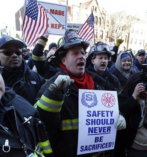 Elizabeth Fire Department firefighters in Trenton, N.J., protest staff cuts and promote public safety. (AP)
