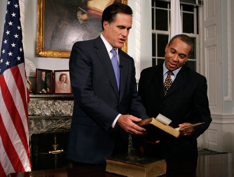 Massachusetts' last two governors, in January 2007. On national television, Gov. Deval Patrick praised former Gov. Mitt Romney for the state's 2006 universal health care law. (AP)