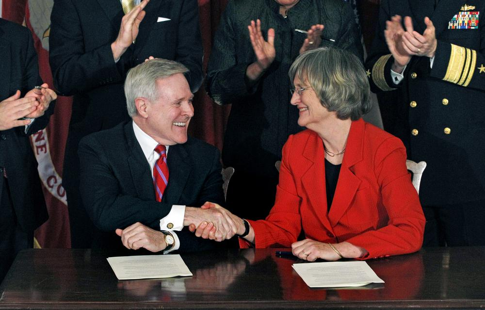 Navy Secretary Ray Mabus, left, shakes hands with Harvard University President Drew Gilpin Faust after signing an agreement on Friday that will recognize the Naval ROTC's formal presence on campus. (AP)