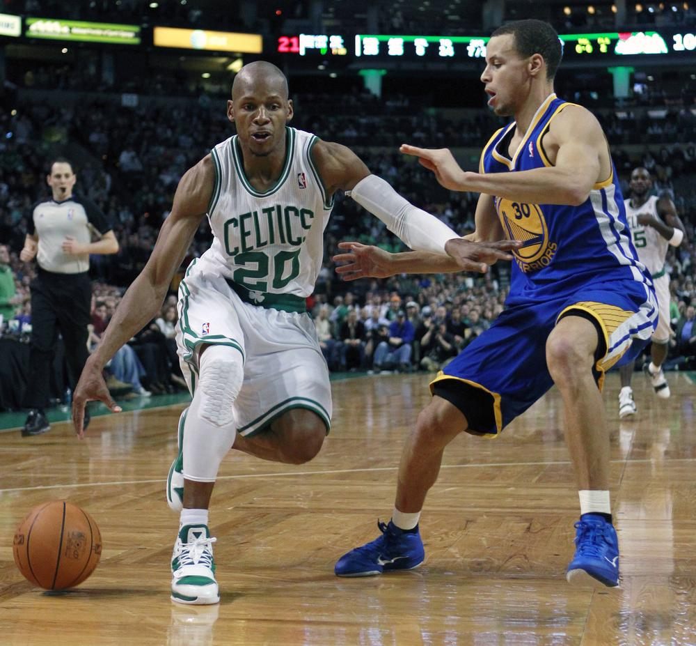 Ray Allen looks to drive past Golden State Warriors' Stephen Curry in the fourth quarter Friday in Boston. (AP)