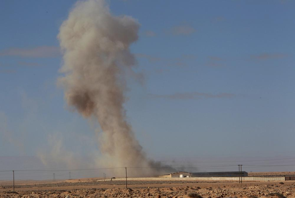Smoke raises from a military army base which fell to the anti-Libyan Leader Moammar Gadhafi rebels following an air strike by Libyan warplanes that attacked in the oil town of Ras Lanouf, eastern Libya, on Sunday.  (AP)