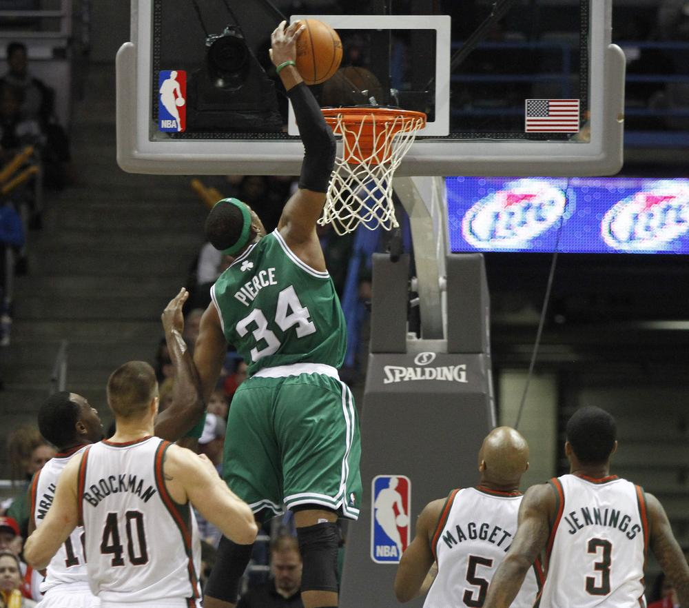Boston Celtics' Paul Pierce, center, goes up for a dunk against the Milwaukee Bucks in the second half of the game Sunday in Milwaukee. (AP)