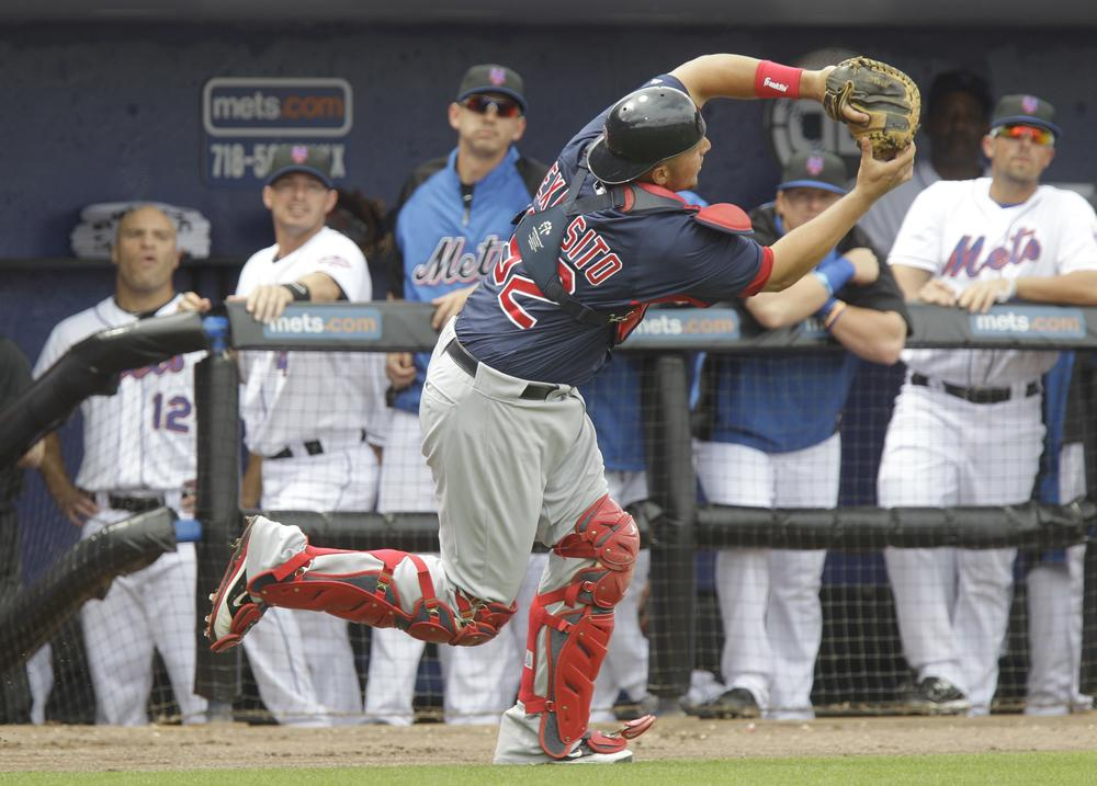 Boston Red Sox catcher Luis Exposito (92) catches a pop-up during a spring training baseball game against the New York Mets on Sunday in Port St. Lucie, Fla. (AP)