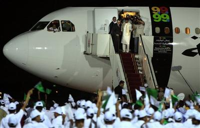 Libyan Abdel Baset al-Megrahi, who found guilty of the 1988 Lockerbie bombing, top  left, is accompanied by Seif al-Islam el- Gadhafi, son of Libyan leader Libyan leader Moammar Gadhafi upon his arrival at airport in Tripoli, Libya, Thursday, Aug. 20, 2009 after Scotland freed the terminally ill Lockerbie bomber on compassionate grounds. (AP)