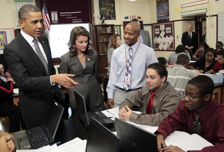 President Obama talks to students during his visit to TechBoston Academy in Dorchester Tuesday. Melinda Gates and teacher James Lewis join the president. (AP)