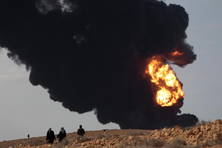 Smoke billows from a fuel storage facility that was attacked during fighting in eastern Libya Wednesday. (AP)