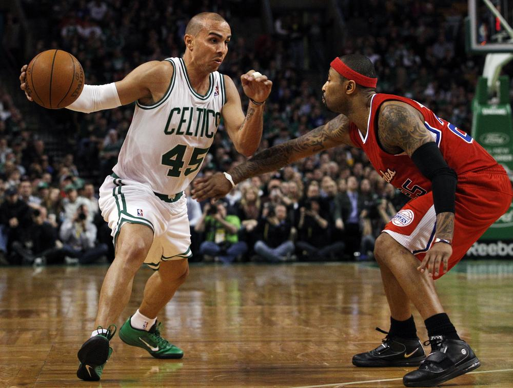 Boston Celtics point guard Carlos Arroyo (45) drives against Los Angeles Clippers guard Mo Williams during the second half of the game in Boston on Wednesday. The Clippers won 108-103. (AP)