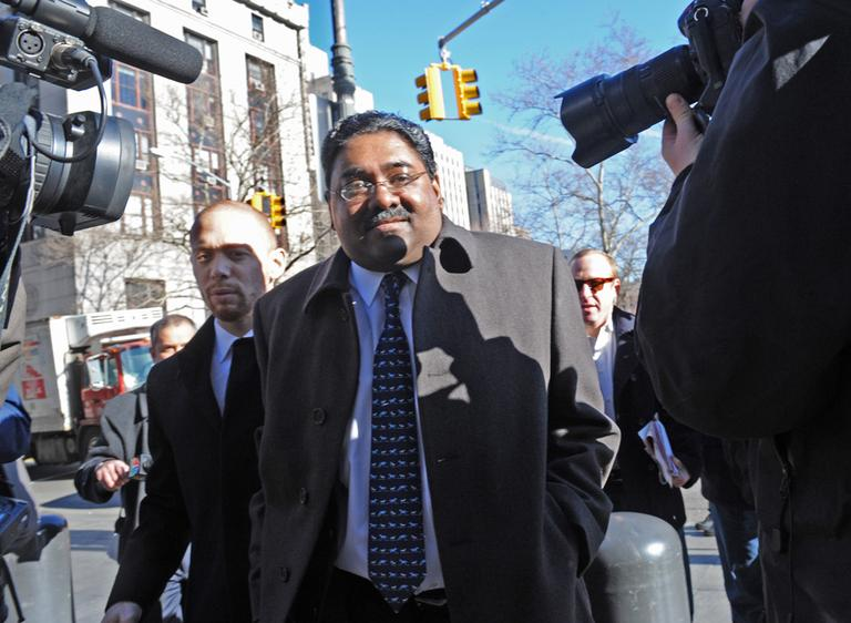 Galleon Group founder Raj Rajaratnam enters Manhattan federal court on the first day of jury selection on March 8, 2011, in New York. He is accused of making more than $50 million off of insider trading. (AP/ Louis Lanzano)