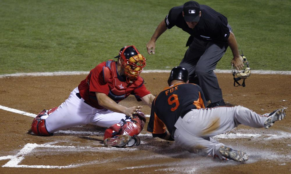 Boston Red Sox catcher Jason Varitek, left, tags out Baltimore Orioles Jake Fox at the plate while trying to score on a fielder's choice hit by the Orioles' Brendan Harris in the second inning of the game in Fort Myers, Fla. on Wednesday. (AP)