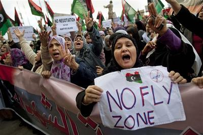 Libyan women protest to demand the resignation of Libyan leader Moammar Gadhafi and for a no-fly zone during a demonstration in Benghazi, eastern Libya. (AP)
