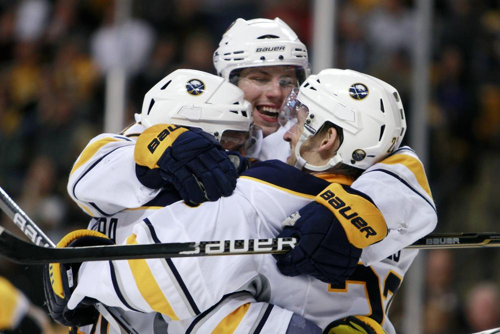 Buffalo Sabres' Brad Boyes, right, celebrates his game-winning goal with teammates Andrej Sekera, left, of Slovakia, and Nathan Gerbe, center, in overtime during the game on Thursday in Boston. The Sabres won 4-3. (AP)