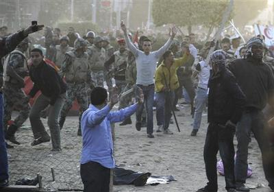 Egyptians who oppose the continued presence of protesters at Tahrir Square, the focal point of the Egyptian uprising in Cairo, and army soldiers prepare to remove the belongings of youths camping out at the square in order to press their demand for a complete break with the ousted regime. (AP)