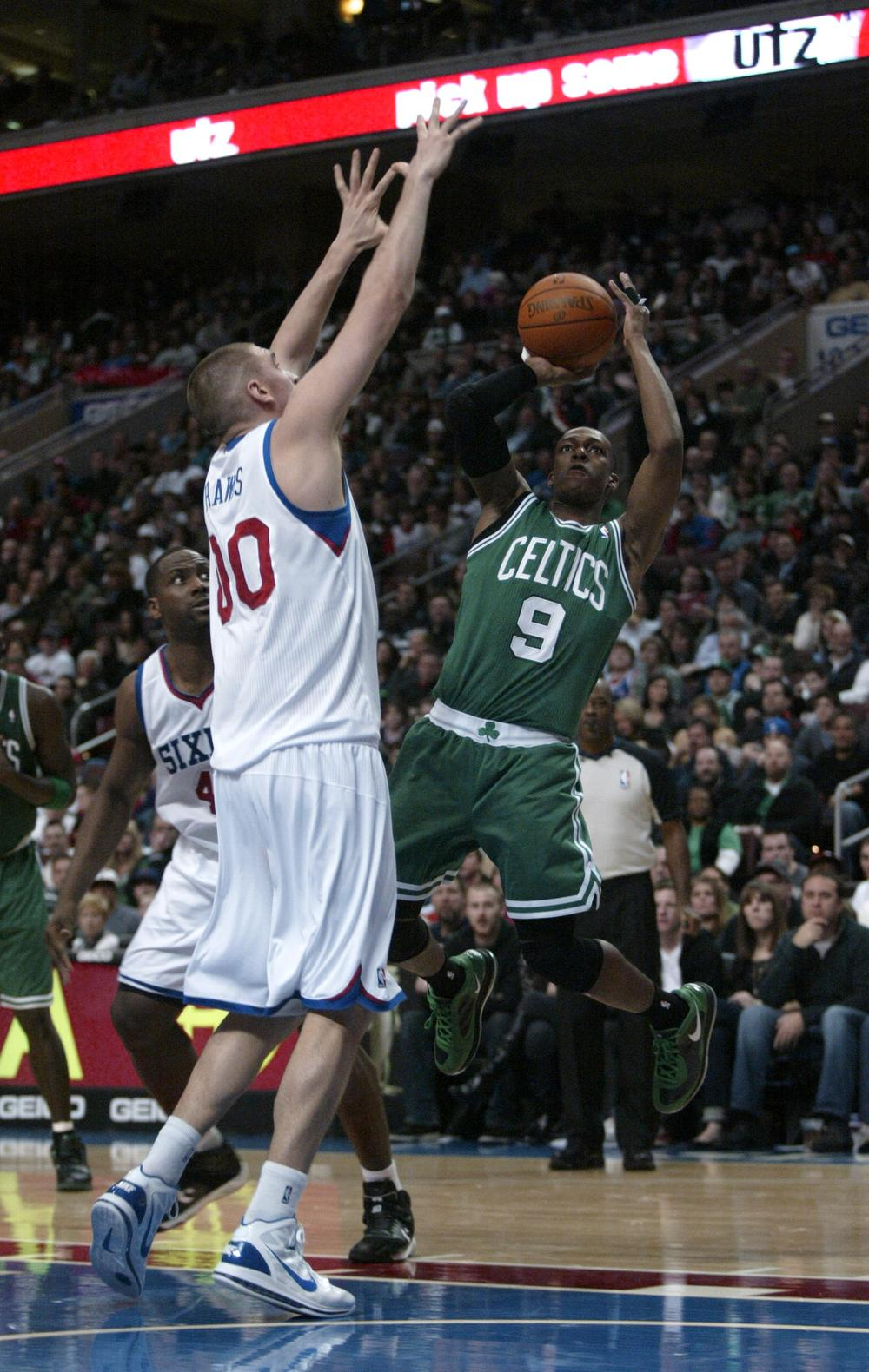 Celtics' Rajon Rondo shoots over Philadelphia 76ers' Spencer Hawes in the first half, Friday in Philadelphia. (AP)