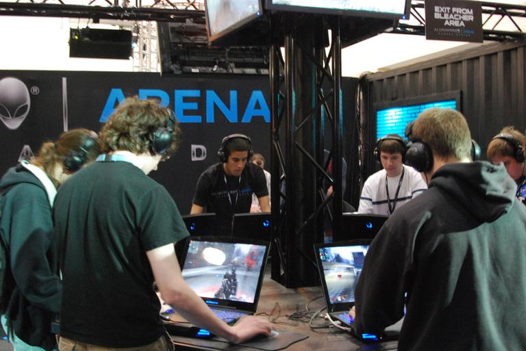 Gamers get their game on at a booth in the BCEC at PAX East 2011. (CasualCapture/Flickr)