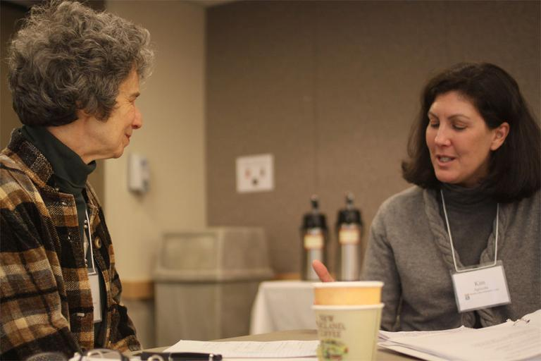 Ellen Westheimer, left, and Kim Agricola discuss end-of-life issues during a Chronic Care Community Corps seminar in Newton. (Kirk Carapezza for WBUR)