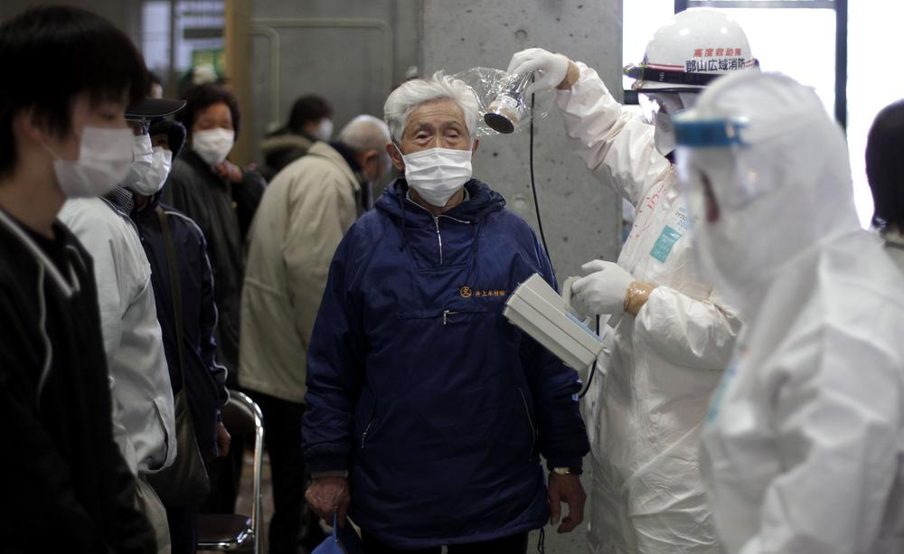 A man is scanned for radiation exposure at a temporary scanning center for residents living close to the quake-damaged Fukushima Dai-ichi nuclear power plant. (AP)