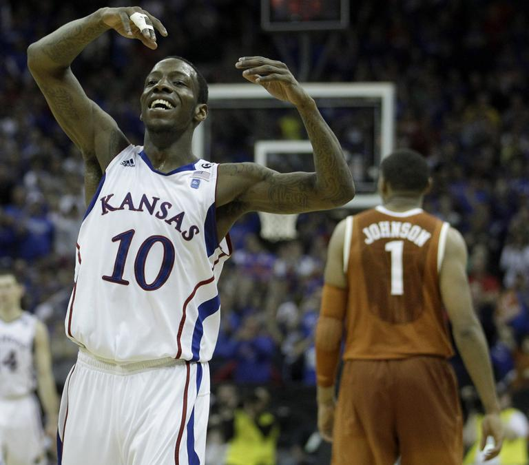 Kansas guard Tyshawn Taylor celebrates after defeating Texas 85-73 to win the Big 12 men's basketball tournament Saturday. (AP)