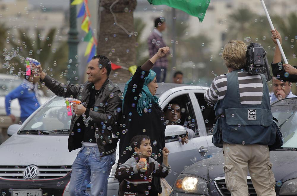 Following the announcement that Moammar Gadhafi's forces took the Eastern city of Ajdabiya, Gadhafi supporters celebrate on Green Square in Tripoli, Libya on Tuesday. (AP)