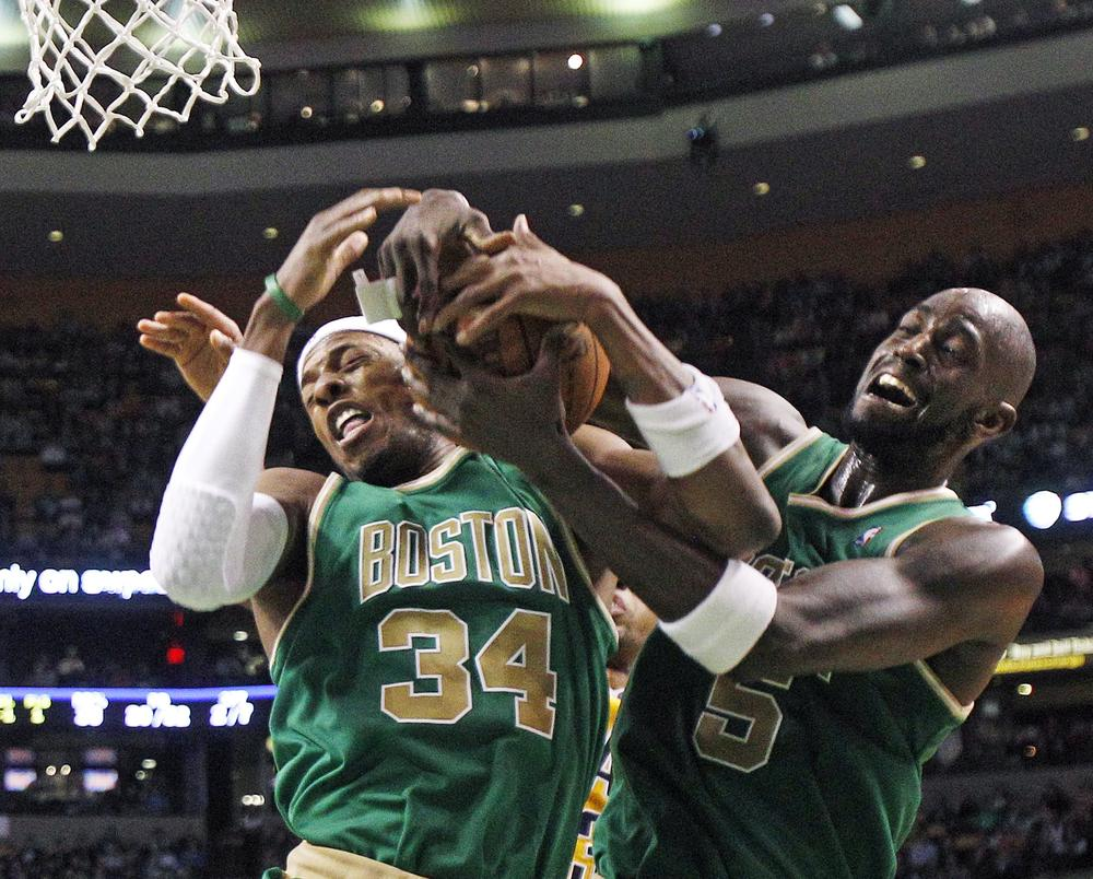 Boston Celtics forwards Paul Pierce (34) and Kevin Garnett (5) go for the same rebound during the second half of the game against the Indiana Pacers in Boston on Wednesday. The Celtics won 92-80. (AP)