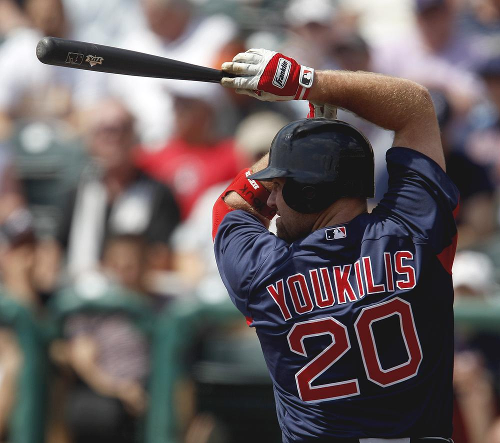 Boston Red Sox third baseman Kevin Youkilis (20) plays in a spring training baseball game against the Atlanta Braves on Wednesday in Kissimmee, Fla. (AP)