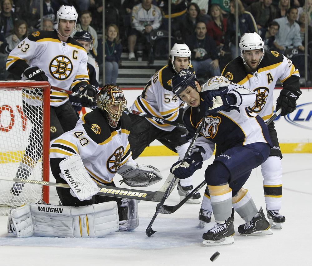 Nashville Predators right wing Jordin Tootoo, front left, chases a rebound after Boston Bruins goalie Tuukka Rask (40), of Finland, blocked a shot in the third period of an NHL hockey game on Thursday in Nashville, Tenn. (AP)