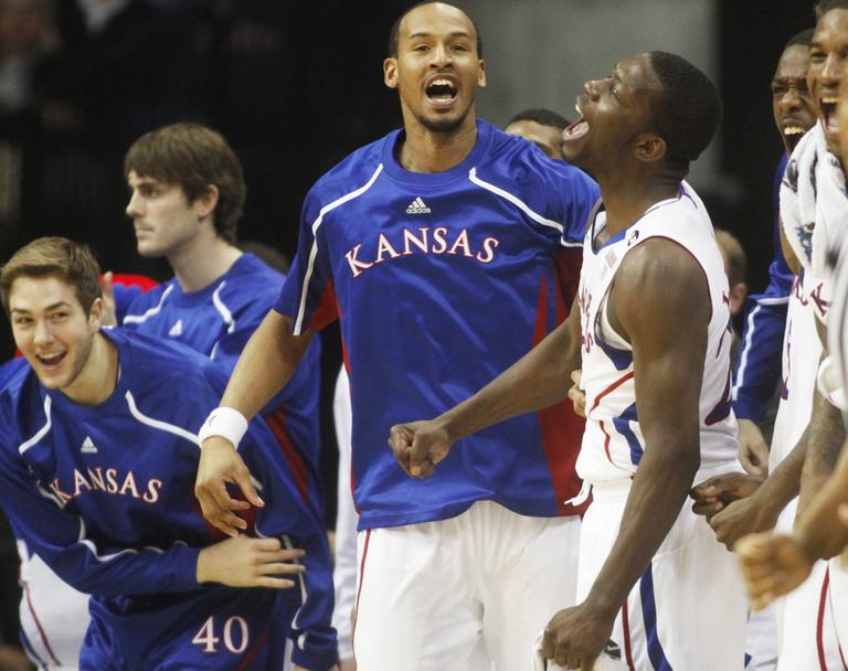 Kansas players including Jordan Juenemann, left, Travis Releford, center, and Mario Little, react to action against Boston University during the Southwest Regional NCAA tournament second round college basketball game, Friday. (AP)
