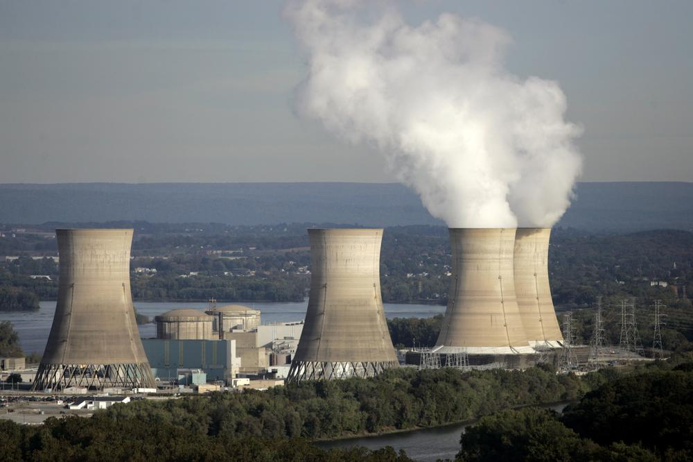 Smoke billows from two active cooling towers of the Three Mile Island nuclear power plant in Middletown, Pa., Wednesday, Oct. 19, 2005. (AP)