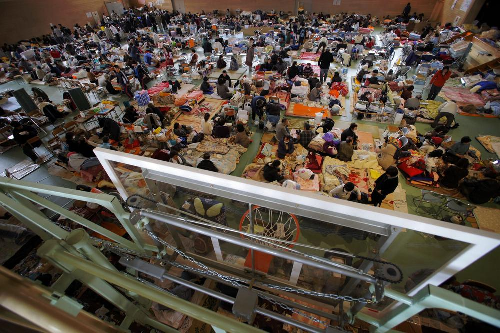 Survivors of Japan's tsunami pack on the floor at an evacuation center in Rikuzentakata, Iwate prefecture, northern Japan, on Saturday. (AP)