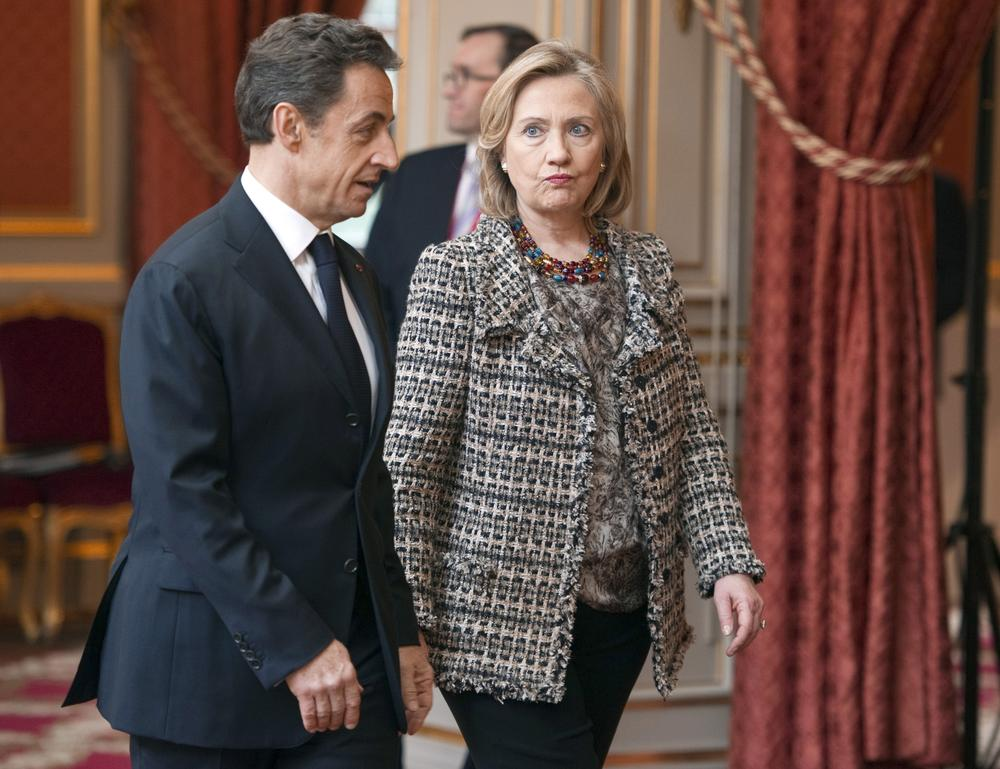 French President Nicolas Sarkozy accompanies U.S. Secretary of State Hillary Clinton on Saturday before a summit at the Elysee Palace in Paris, on implementing the U.N. Security Council resolution 1973 authorizing military action in Libya.  (AP/Pool)
