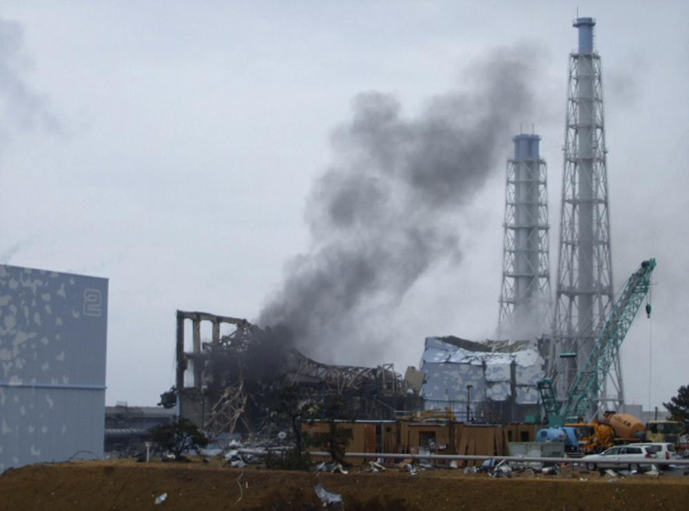 In this photo released by Tokyo Electric Power Co. (TEPCO), gray smoke rises from Unit 3 of the tsunami-stricken Fukushima Dai-ichi nuclear power plant in Okumamachi, Fukushima Prefecture, Japan. (AP)