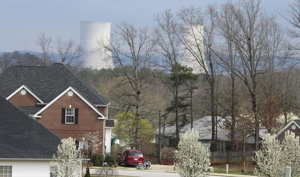 The cooling towers at the Tennessee Valley Authority's Sequoyah Nuclear Plant rise above the trees near a residential neighborhood in Soddy-Daisy, Tenn. (AP)