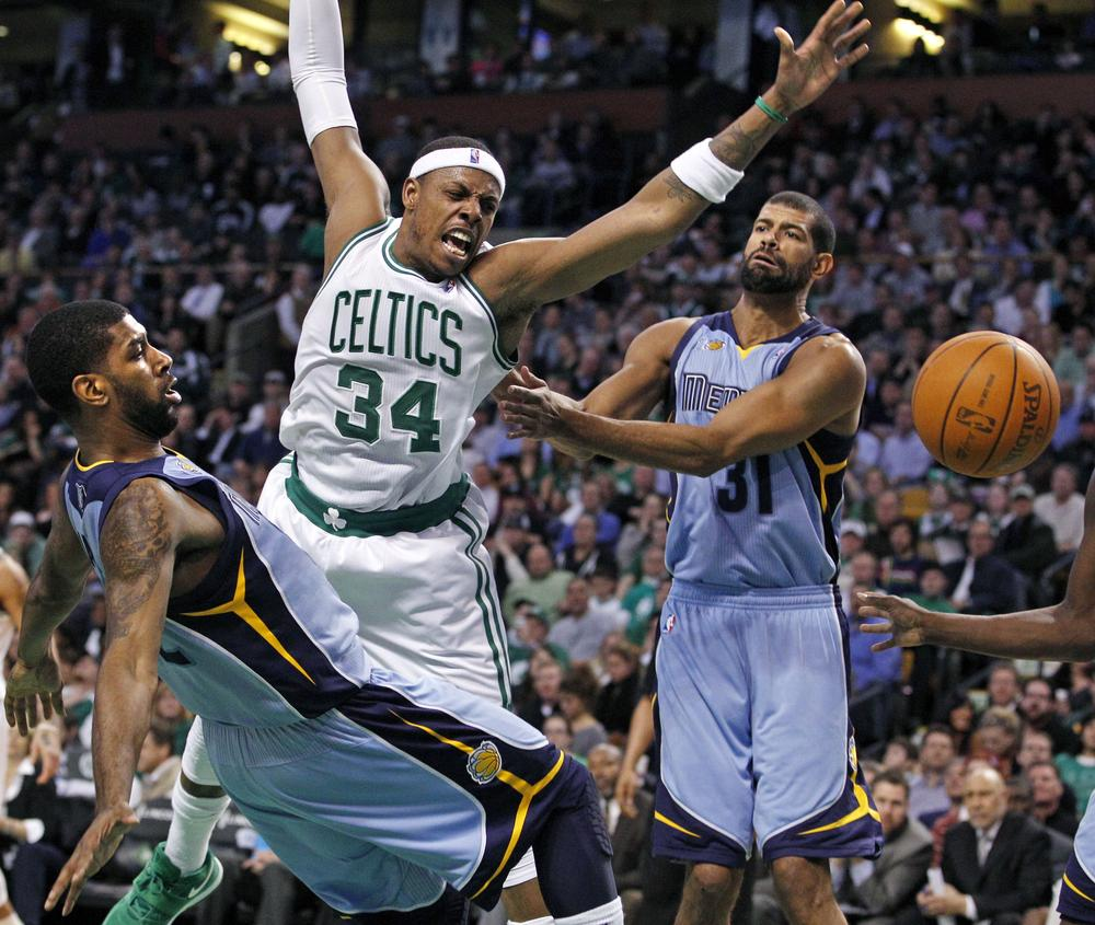 Boston Celtics forward Paul Pierce (34) has the ball knocked away as he drives against Memphis Grizzlies guard O.J. Mayo, left, and forward Shane Battier (31) during the first quarter of the game in Boston on Wednesday. (AP)