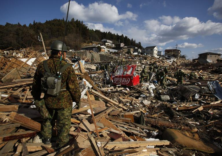 Members of Japan's Self Defense Force search the rubble of Shizugawa, in Northeastern Japan. (AP)