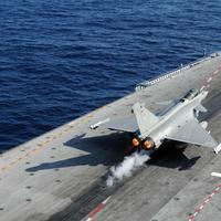 A French Navy Rafale jet fighter takes off the flight deck of Charles de Gaulle aircraft carrier in the Mediterranean sea as part of the Operation Odyssey Dawn. (AP/French Army)