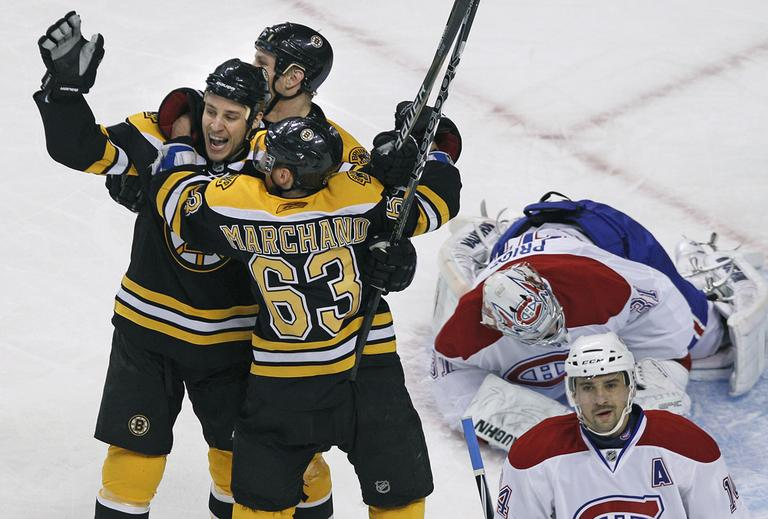 Boston Bruins center Gregory Campbell, left, celebrates his goal with teammates Shawn Thornton, middle, and Brad Marchand as Montreal Canadiens goalie Carey Price and center Tomas Plekanec react Thursday. (AP)