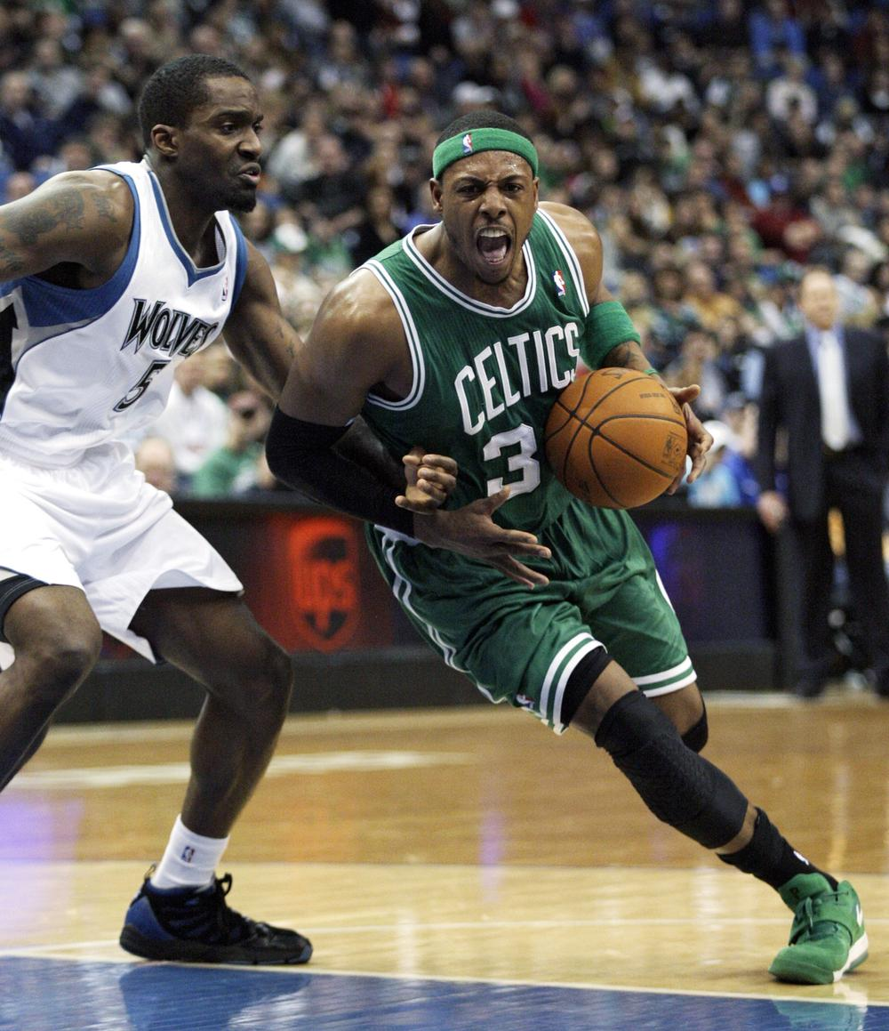 Boston Celtics forward Paul Pierce (34) drives around Minnesota Timberwolves forward Martell Webster (5) during the first half of the game on Sunday in Minneapolis. (AP)