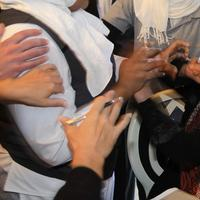 Hands from hotel employees trying to grab her, and foreign journalist attempting to protect her, surround Iman Al-Obeidi, right, who said she spent two days in detention after being arrested at a checkpoint in Tripoli, Libya, and was sexually assaulted by up to 15 men while in custody. (AP)