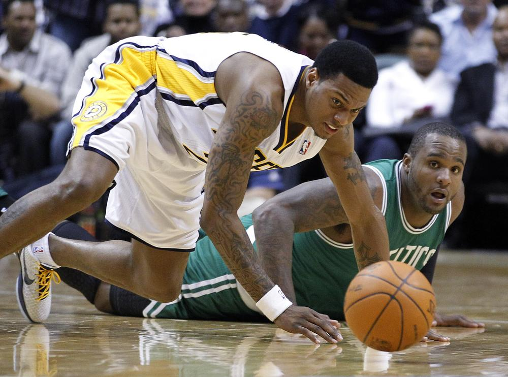 Indiana Pacers guard Brandon Rush, left, and Boston Celtics forward Glen Davis go to the floor for a loose ball in the second half the game in Indianapolis on Monday. The Pacers defeated the Celtics 107-100. (AP)