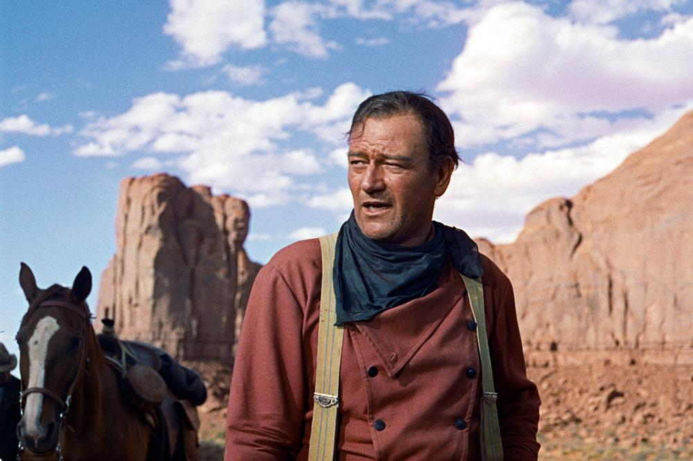 "Actor John Wayne plays Ethan Edwards in the 1956 film ""The Searchers."" (AP/Warner Bros.)"