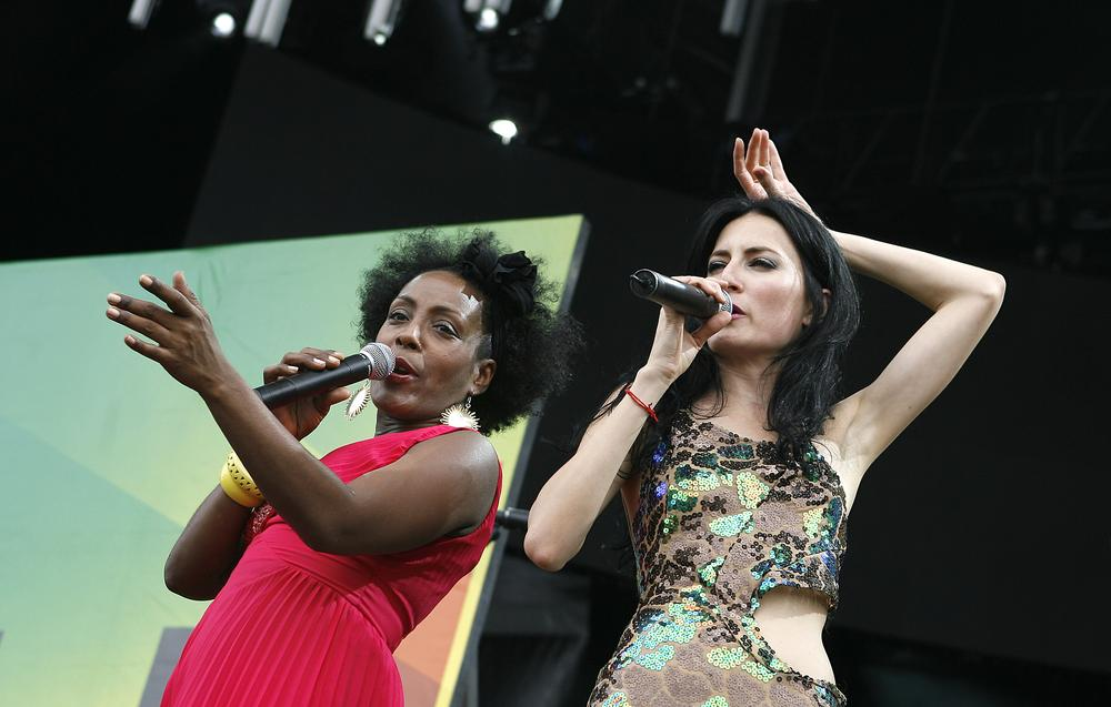 Xiomara Laugart, left, and CuCu Diamantes of Yerba Buena perform in New York. The artists will attend the upcoming Sí Cuba festival in New York City. (AP)