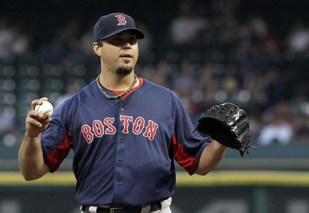 Boston Red Sox pitcher Josh Beckett waits for a batter to get ready during the first inning of the game against the Houston Astros Wednesday in Houston. Beckett pitched five shutout innings, giving up only one hit. (AP)