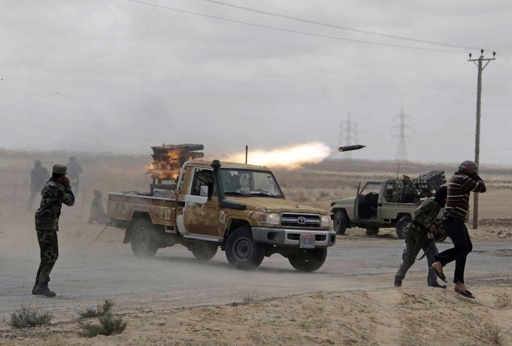 Libyan rebels fire rockets at troops loyal to Libyan leader Moammar Gadhafi on the road between Ajdabiya and Brega, Libya. (AP)
