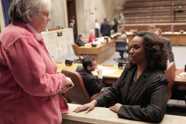 In this file photo, Boston City Councilor Ayanna Pressley, right, talks with Anne Schmalz, an observer from the League of Women Voters, at a recent council meeting. (Nick Dynan for WBUR)