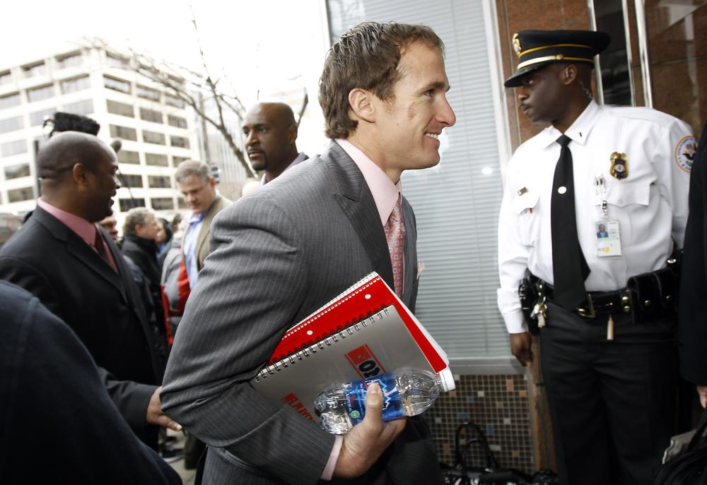 New Orleans Saints quarterback Drew Brees arrives for negotiations with the NFL involving a federal mediator. (AP)
