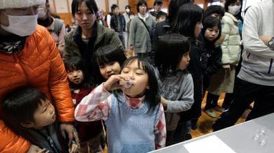 Children in Kawamata, Japan, take potassium iodide
