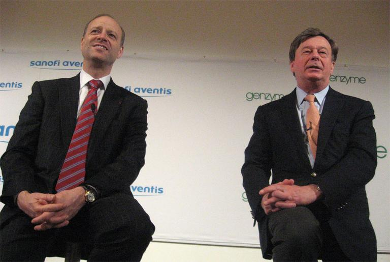 Sanofi-Aventis CEO Chris Viehbacher, left, and Genzyme CEO Henri Termeer at a news conference in February (Curt Nickisch/WBUR)